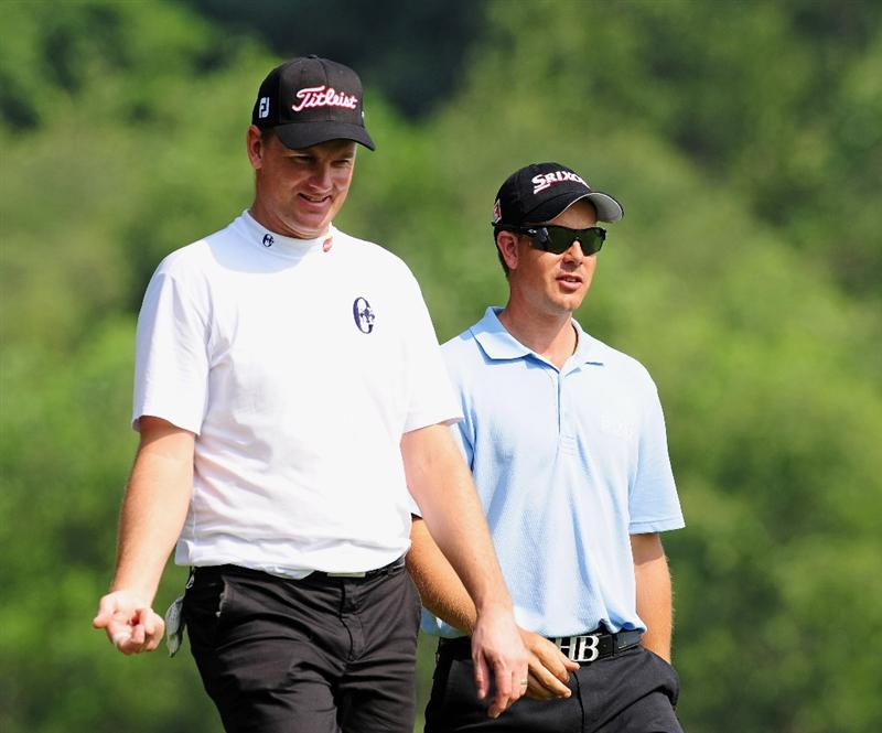 SHENZHEN, GUANGDONG - NOVEMBER 25: Defending champions Robert Karlsson and Henrik Stenson of Sweden look on during pro - am the Omega Mission Hills World Cup on the Olazabal course on November 25, 2009 in Shenzhen, China. (Photo by Stuart Franklin/Getty Images)