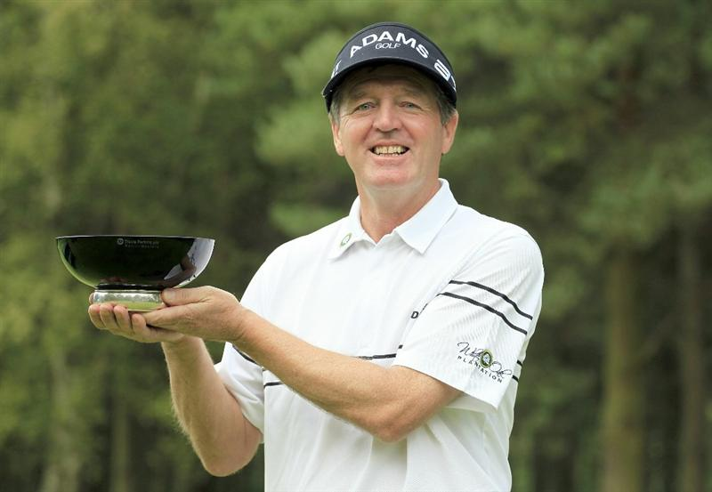 WOBURN, ENGLAND - SEPTEMBER 05:  Des Smyth of Ireland poses with the trophy after the final round of the Travis Perkins plc Senior Masters played on the Duke's Course, Woburn Golf Club on September 5, 2010 in Woburn, England.  (Photo by Phil Inglis/Getty Images)