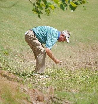 John Harris pulls a ball from the creek  on the 18th hole  during the second round of  the 2005 Bruno's Memorial Classic, May 21, in Hoover, Al.Photo by Al Messerschmidt/WireImage.com