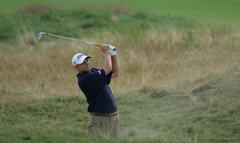 NORTON, MA - SEPTEMBER 05:  Bill Haas of the United States plays a shot from a fairway bunker during the second round of the Deutsche Bank Championship at TPC Boston held on September 5, 2009 in Norton, Massachusetts.  (Photo by Michael Cohen/Getty Images)
