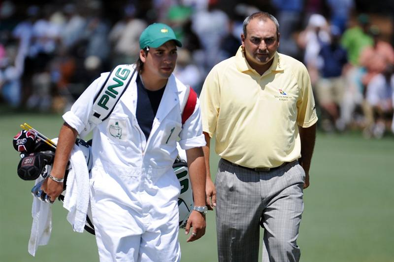 AUGUSTA, GA - APRIL 11:  Angel Cabrera of Argentina (R) walks to the second hole with his caddie Ruben Yorio during the final round of the 2010 Masters Tournament at Augusta National Golf Club on April 11, 2010 in Augusta, Georgia.  (Photo by Harry How/Getty Images)