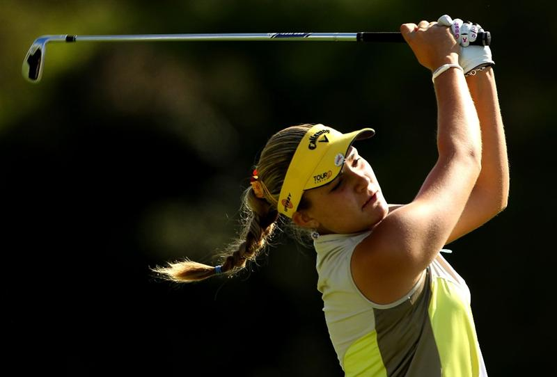 MELBOURNE, AUSTRALIA - MARCH 11:  Alexis Thompson of the USA hits her second shot on the 13th hole during round one of the 2010 Women's Australian Open at The Commonwealth Golf Club on March 11, 2010 in Melbourne, Australia.  (Photo by Mark Dadswell/Getty Images)