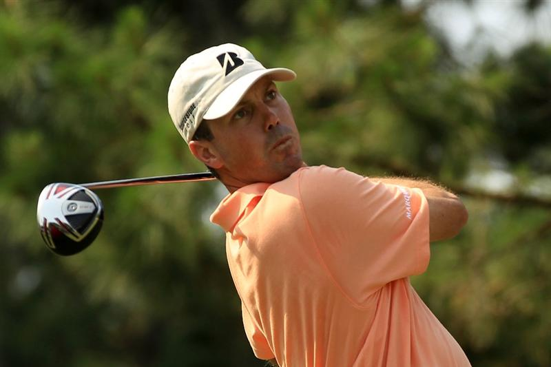 PONTE VEDRA BEACH, FL - MAY 12:  Matt Kuchar hits a tee shot on the ninth hole during the first round of THE PLAYERS Championship held at THE PLAYERS Stadium course at TPC Sawgrass on May 12, 2011 in Ponte Vedra Beach, Florida.  (Photo by Streeter Lecka/Getty Images)