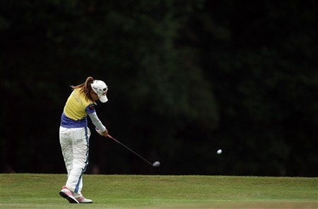 SUNNINGDALE, UNITED KINGDOM - AUGUST 03:  Momoko Ueda of Japan hits her second shot at the 2nd hole during the final round of the 2008  Ricoh Women's British Open Championship held on the Old Course at Sunningdale Golf Club, on August 3, 2008 in Sunningdale, England.  (Photo by David Cannon/Getty Images)