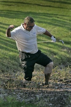Fuzzy Zoeller attempts to hit his ball out of the muck along the 18th during the second round of the Bruno's Memorial Classic, May 21,2005, held at Greystone GC, Birmingham, Al.  D.A. Weibring shot a second round 12 under par.Photo by Stan Badz/PGA TOUR/WireImage.com