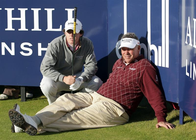 KINGSBARNS, SCOTLAND - OCTOBER 07:  Rory McIlroy and Darren Clarke of Northern Ireland wait to tee off on the 18th tee during the first round of The Alfred Dunhill Links Championship at Kingsbarns Golf Links on October 7, 2010 in Kingsbarns, Scotland.  (Photo by Andrew Redington/Getty Images)