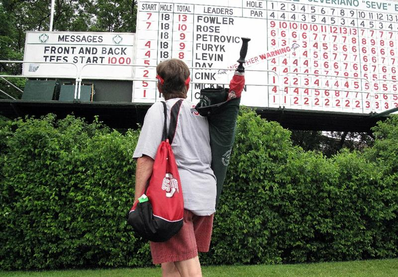 DUBLIN, OH - JUNE 05:  A golf fan looks at the main leaderboard after play was suspended by dangerous weather during the third round of the Memorial Tournament presented by Morgan Stanley at Muirfield Village Golf Club on June 5, 2010 in Dublin, Ohio.  (Photo by Scott Halleran/Getty Images)