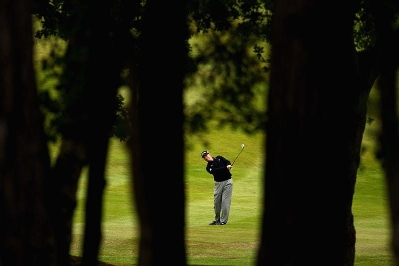 VIRGINIA WATER, ENGLAND - MAY 26: Richard McEvoy of England plays his second shot on the seventh hole during the first round of the BMW PGA Championship at Wentworth Club on May 26, 2011 in Virginia Water, England.  (Photo by Richard Heathcote/Getty Images)