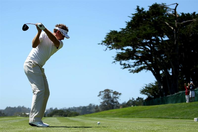 PEBBLE BEACH, CA - JUNE 16:  Ian Poulter of England hits a tee shot during a practice round prior to the start of the 110th U.S. Open at Pebble Beach Golf Links on June 16, 2010 in Pebble Beach, California.  (Photo by Andrew Redington/Getty Images)