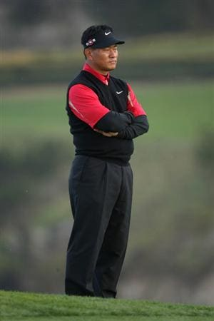 PEBBLE BEACH, CA - FEBRUARY 12:  K. J. Choi of South Korea waits on the sixth hole during the first round of the AT&T Pebble Beach National Pro-Am at Pebble Beach Golf Links on February 12, 2009 in Pebble Beach, California.  (Photo by Stephen Dunn/Getty Images)