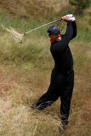 PEBBLE BEACH, CA - JUNE 20:  Tiger Woods plays a shot from the rough on the third hole during the final round of the 110th U.S. Open at Pebble Beach Golf Links on June 20, 2010 in Pebble Beach, California.  (Photo by Donald Miralle/Getty Images)
