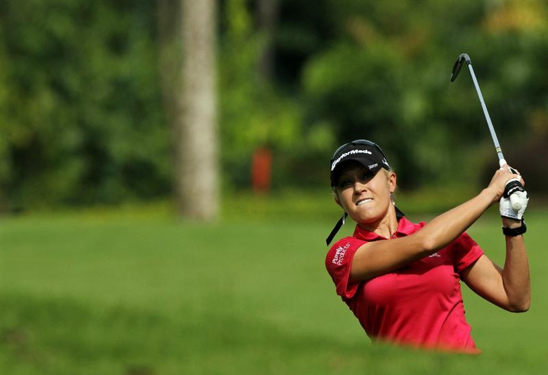 KUALA LUMPUR, MALAYSIA - OCTOBER 22:  Natalie Gulbis of USA hits her 2nd shot out of the bunker on the 1st hole during Round One of the Sime Darby LPGA on October 22, 2010 at the Kuala Lumpur Golf and Country Club in Kuala Lumpur, Malaysia. (Photo by Stanley Chou/Getty Images)