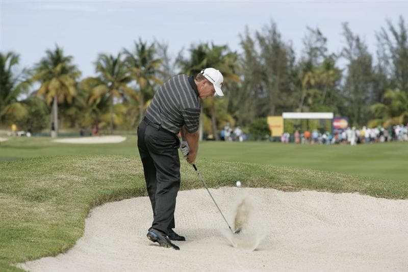 RIO GRANDE, PR - MARCH 13: Michael Bradley hits his second shot on the 15th hole from a fairway bunker during the final round of the Puerto Rico Open presented by seepuertorico.com at Trump International Golf Club on March 13, 2011 in Rio Grande, Puerto Rico.  (Photo by Michael Cohen/Getty Images)