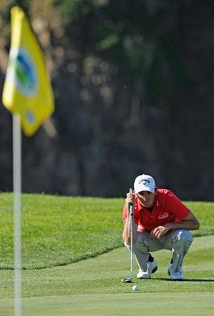 PEBBLE BEACH, CA - FEBRUARY 11:  Sam Saunders lines up his putt on the eighth hole during the second round of the AT&T Pebble Beach National Pro-Am at the Pebble Beach Golf Links on February 11, 2011  in Pebble Beach, California  (Photo by Stuart Franklin/Getty Images)