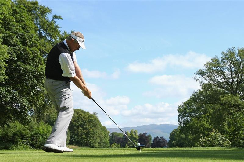 LUSS, SCOTLAND - JULY 11:  Colin Montgomerie of Scotland tees off on the 16th hole during the Third Round of The Barclays Scottish Open at Loch Lomond Golf Club on July 11, 2009 in Luss, Scotland.  (Photo by Andrew Redington/Getty Images)
