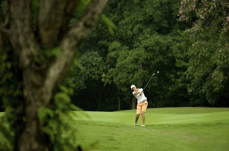 SINGAPORE - MARCH 07:  Juli Inkster of the USA plays her second shot on the par four 4th hole during the third round of HSBC Women's Champions at the Tanah Merah Country Club on March 7, 2009 in Singapore.  (Photo by Victor Fraile/Getty Images)