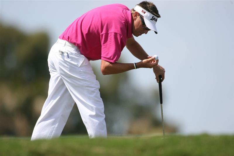 DORAL, FL - MARCH 14:  Robert Allenby of Australia looks at his golf ball on the second hole during the final round of the 2010 WGC-CA Championship at the TPC Blue Monster at Doral on March 14, 2010 in Doral, Florida.  (Photo by Marc Serota/Getty Images)
