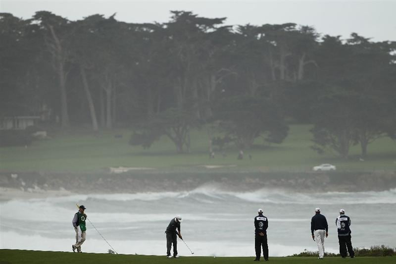PEBBLE BEACH, CA - FEBRUARY 12:  Dustin Johnson putts on the 13th hole during round two of the AT&T Pebble Beach National Pro-Am at the Monterey Peninsula Country Club Shore Course on February 12, 2010 in Pebble Beach, California.  (Photo by Ezra Shaw/Getty Images)
