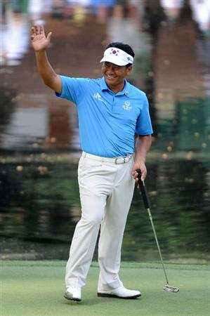 AUGUSTA, GA - APRIL 07:  K.J. Choi of South Korea waves to the gallery during the Par 3 Contest prior to the 2010 Masters Tournament at Augusta National Golf Club on April 7, 2010 in Augusta, Georgia.  (Photo by Harry How/Getty Images)
