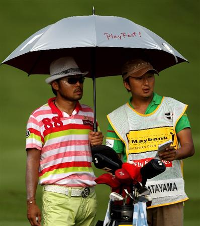 KUALA LUMPUR, MALAYSIA - MARCH 05:  Shingo Katayama of Japan waits with his caddie on the 14th hole during the the second round of the Maybank Malaysian Open at the Kuala Lumpur Golf and Country Club on March 5, 2010 in Kuala Lumpur, Malaysia.  (Photo by Andrew Redington/Getty Images)