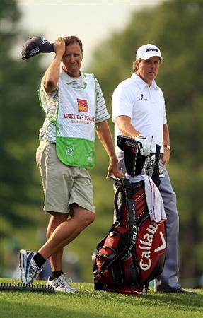 CHARLOTTE, NC - MAY 07:  Phil Mickelson and his caddie Jim Mackay wait to hit on the 16th hole during the third round of the Wells Fargo Championship at Quail Hollow Club on May 7, 2011 in Charlotte, North Carolina.  (Photo by Streeter Lecka/Getty Images)