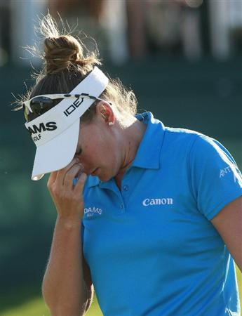 PRATTVILLE, AL - OCTOBER 3:  Brittany Lang reacts after making a bogie on the 18th hole during third round play in the Navistar LPGA Classic at the Robert Trent Jones Golf Trail at Capitol Hill on October 3, 2009 in  Prattville, Alabama.  (Photo by Dave Martin/Getty Images)