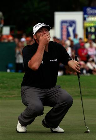 HONOLULU, HI - JANUARY 16:  Steve Marino reacts to a missed eagle putt on the 18th hole during the final round of the Sony Open at Waialae Country Club on January 16, 2011 in Honolulu, Hawaii.  (Photo by Sam Greenwood/Getty Images)