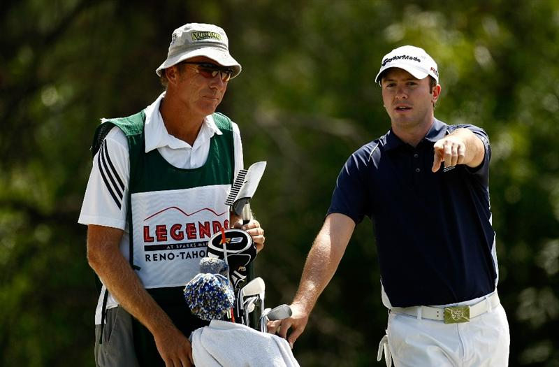 RENO, NV - AUGUST 09:  Martin Laird discusses a putt with his caddie on the seventh hole during the final round of the Legends Reno-Tahoe Open on August 9, 2009 at Montreux Golf and Country Club in Reno, Nevada.  (Photo by Jonathan Ferrey/Getty Images)
