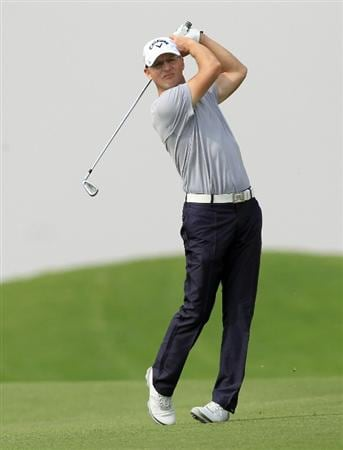 BAHRAIN, BAHRAIN - JANUARY 28:  Niclas Fasth of Sweden plays his second shot at the 17th hole during the second round of the 2011 Volvo Champions held at the Royal Golf Club on January 28, 2011 in Bahrain, Bahrain.  (Photo by David Cannon/Getty Images)