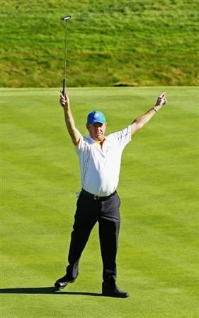 NEWPORT, WALES - OCTOBER 04:  Miguel Angel Jimenez of Europe celebrates holing a putt on the 15th green in the singles matches during the 2010 Ryder Cup at the Celtic Manor Resort on October 4, 2010 in Newport, Wales.  (Photo by Andy Lyons/Getty Images)