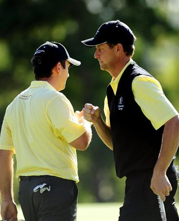 PARIS - SEPTEMBER 25: Francesco Molinari and Anders Hansen of the Continental Europe team celebrate their win on the 17th hole during the second day fourball at The Vivendi Trophy with Severiano Ballesteros at Saint - Nom - La Breteche golf course on September 25, 2009 in Paris, France.  (Photo by Stuart Franklin/Getty Images)