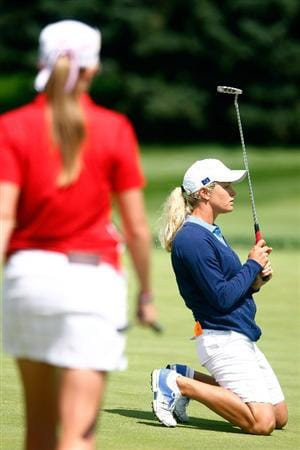 SUGAR GROVE, IL - AUGUST 23:  Suzann Pettersen of the European Team reacts to a missed putt on the 15th hole as Paula Creamer of the U.S. Team looks on during the Sunday singles matches at the 2009 Solheim Cup at Rich Harvest Farms on August 23, 2009 in Sugar Grove, Illinois.  (Photo by Scott Halleran/Getty Images)
