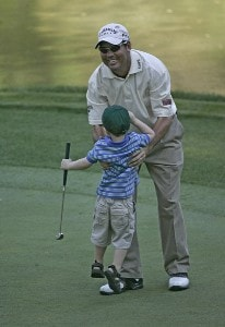 Rich Beem and his son during the par 3 contest prior to the 2006 Masters at the Augusta National Golf Club in Augusta, Georgia on April 5, 2006.Photo by Sam Greenwood/WireImage.com