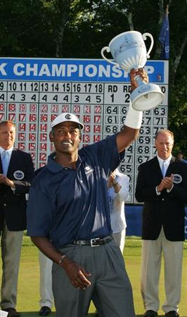 NORTON, MA - SEPTEMBER 01:  Vijay Singh of Fiji Islands holds the champion's trophy after the final  round of the Deutsche Bank Championship at TPC of Boston held on September 1, 2008 in Norton, Massachusetts.  (Photo by Michael Cohen/Getty Images)