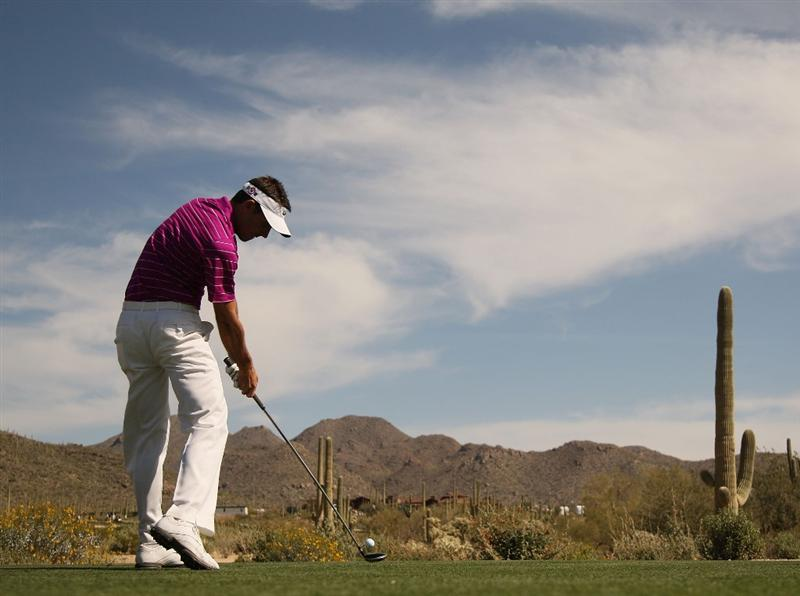 MARANA, AZ - FEBRUARY 19:  Charl Schwartzel of South Africa tees off on the ninth tee box during round three of the Accenture Match Play Championship at the Ritz-Carlton Golf Club on February 19, 2010 in Marana, Arizona.  (Photo by Darren Carroll/Getty Images)