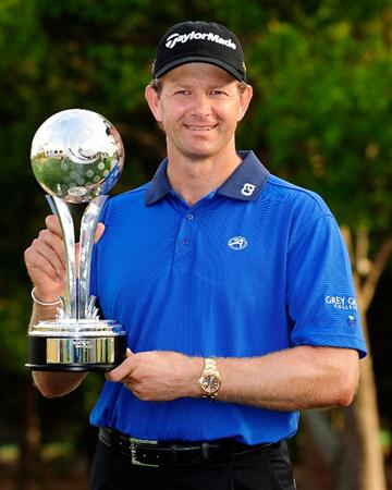 PALM HARBOR, FL - MARCH 22:  Retief Goosen of South Africa holds the trophy after winning the Transitions Championship at the Innisbrook Resort and Golf Club on March 22, 2009 in Palm Harbor, Florida.  (Photo by Sam Greenwood/Getty Images)