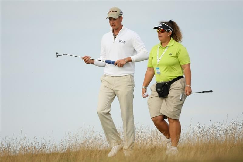 TURNBERRY, SCOTLAND - JULY 15:   Henrik Stenson of Sweden walks with his caddie Fanny Sunesson during a practice round prior to the 138th Open Championship on the Ailsa Course, Turnberry Golf Club on July 15, 2009 in Turnberry, Scotland.  (Photo by Andrew Redington/Getty Images)