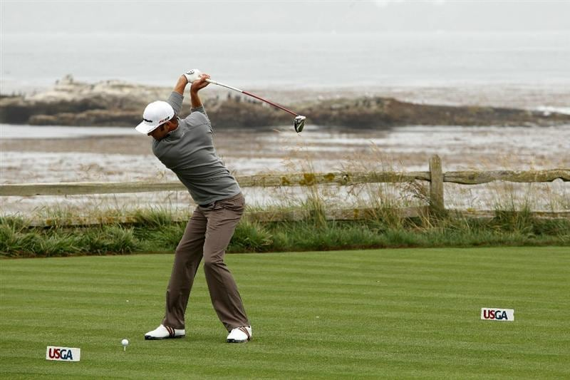 PEBBLE BEACH, CA - JUNE 14:  Tiger Woods hits a tee shot during a practice round prior to the start of the 110th U.S. Open at Pebble Beach Golf Links on June 14, 2010 in Pebble Beach, California.  (Photo by Ross Kinnaird/Getty Images)