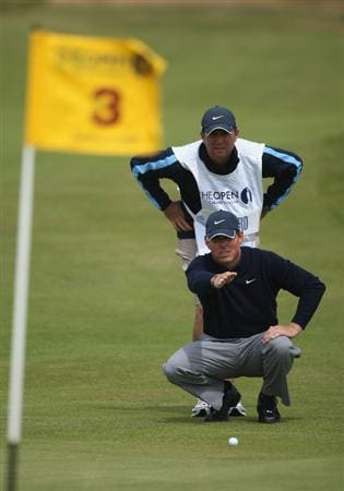 TURNBERRY, SCOTLAND - JULY 18:  Justin Leonard of USA lines up a putt on the 3rd hole with his caddy during round three of the 138th Open Championship on the Ailsa Course, Turnberry Golf Club on July 18, 2009 in Turnberry, Scotland.  (Photo by Andrew Redington/Getty Images)