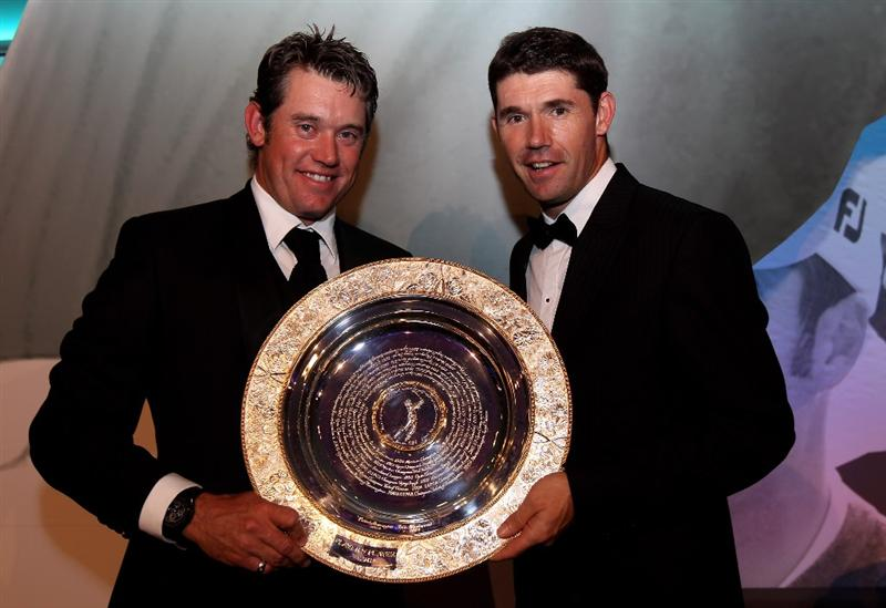 VIRGINIA WATER, ENGLAND - MAY 18:  Lee Westwood of England is presented with the Players' Player Award by Padraig Harrington (R) of Ireland during the 2010 Tour Dinner prior to the BMW PGA Championship on the West Course at Wentworth on May 18, 2010 in Virginia Water, England.  (Photo by Andrew Redington/Getty Images)