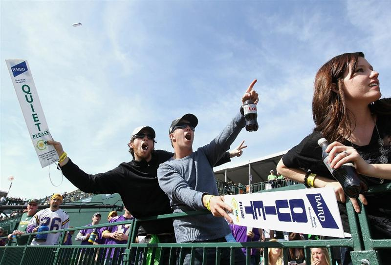 SCOTTSDALE, AZ - FEBRUARY 05:  Fans (L-R) Kyle Leonardo and Chris Olson of Phoenix, AZ cheer on the 16th hole during the second round of the Waste Management Phoenix Open at TPC Scottsdale on February 5, 2011 in Scottsdale, Arizona.  (Photo by Christian Petersen/Getty Images)