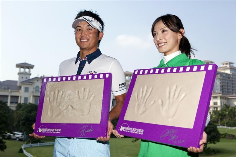 HAIKOU, CHINA - OCTOBER 29:  (L - R) Ryuji Imada of Japan and Actress Ai Katoh of Japan pose with their handprints during a press conference as part the Mission Hills Star Trophy tournament at Mission Hills Resort on October 29, 2010 in Haikou, China. The Mission Hills Star Trophy is Asia's leading leisure liflestyle event and features Hollywood celebrities and international golf stars.  (Photo by Athit Perawongmetha/Getty Images for Mission Hills)