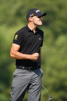 SHENZHEN, CHINA - NOVEMBER 24:  Gregory Havret of France celebrates his birdie putt on the nineth hole during the third round of the Omega Mission Hills World Cup at the Mission Hills Golf Resort on November 24, 2007 in Shenzhen, China.  (Photo by Stuart Franklin/Getty Images)