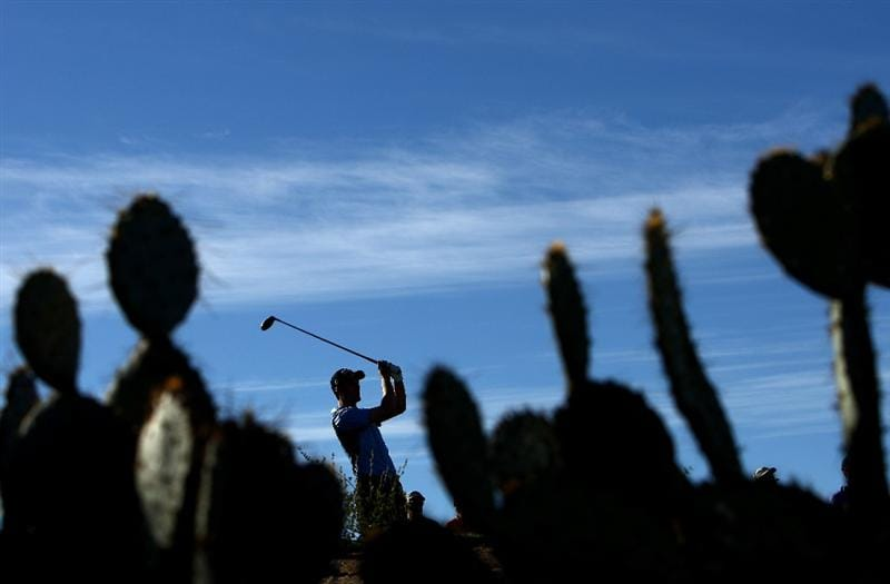 MARANA, AZ - FEBRUARY 28:  Ross Fisher of England tees off the 5th hole against Justin Leonard of the USA during the quarter-final round of the Accenture Match Play Championships at the Ritz-Carlton Golf Club at Dove Mountain on February 28, 2009 in Marana, Arizona. (Photo by Donald Miralle/Getty Images)