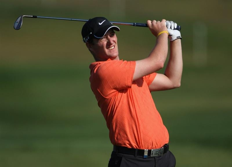 VILAMOURA, PORTUGAL - OCTOBER 15:  Marc Warren of Scotland plays his second shot on the ninth hole during the first round of the Portugal Masters at the Oceanico Victoria Golf Course on October 15, 2009 in Vilamoura, Portugal.  (Photo by Andrew Redington/Getty Images)