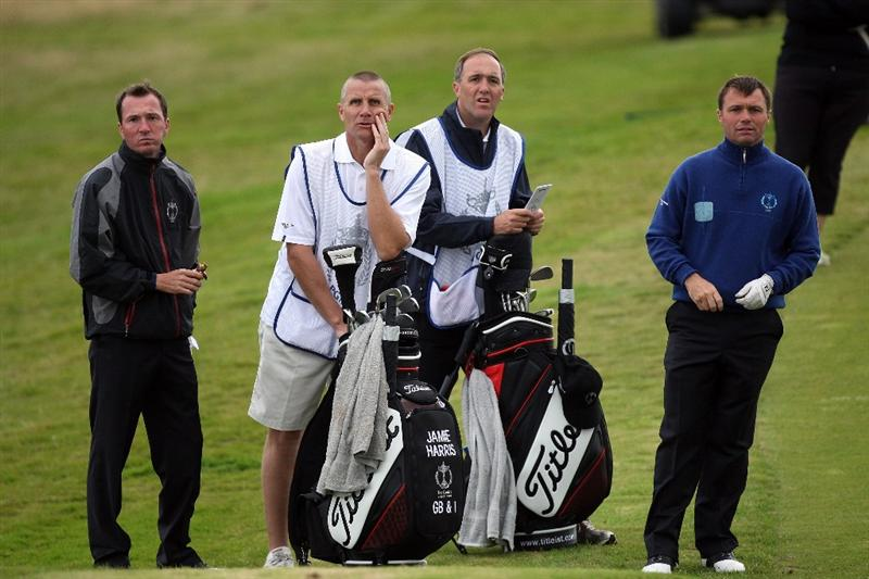 DUMBARTON, SCOTLAND - SEPTEMBER 19: Jamie Harris of England (L) and Paul Simpson of England (R) and the Great Britain and Ireland Team walk onto the 10th green during the morning foursome matches at The Carrick on Loch Lomond on September 19, 2009 in Dumbarton, Scotland.  (Photo by David Cannon/Getty Images)