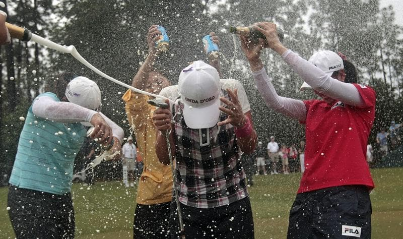 MOBILE, AL - MAY 16: Se Ri Pak of South Korea is doused with beer and champagne after winning a sudden death playoff in the Bell Micro LPGA Classic at the Magnolia Grove Golf Course on May 16, 2010 in Mobile, Alabama. Pak beat Suzann Pettersen and Brittany Lincicome in the playoff after the tournament was shortened to 54-holes because of rain. (Photo by Dave Martin/Getty Images)