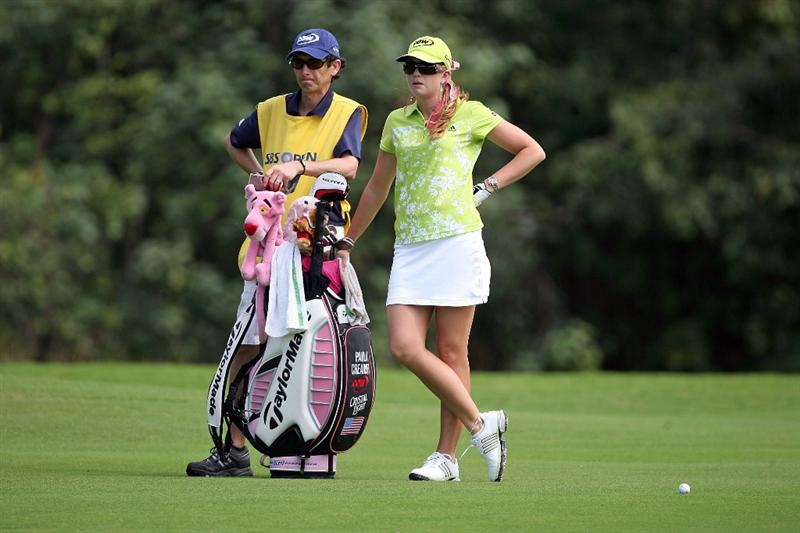 KAHUKU, HI - FEBRUARY 12:  Paula Creamer and her caddie stand in the fairway on the 7th hole during the first round of the SBS Open on February 12, 2009  at the Turtle Bay Resort in Kahuku, Hawaii.  (Photo by Andy Lyons/Getty Images)