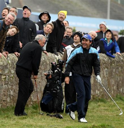 ST ANDREWS, SCOTLAND - OCTOBER 09:  Former Dutch football star Johan Cruyff  plays from along side the raod on the par four 17th hole during the third round of The Alfred Dunhill Links Championship at The Old Course on October 9, 2010 in St Andrews, Scotland.  (Photo by Ross Kinnaird/Getty Images)