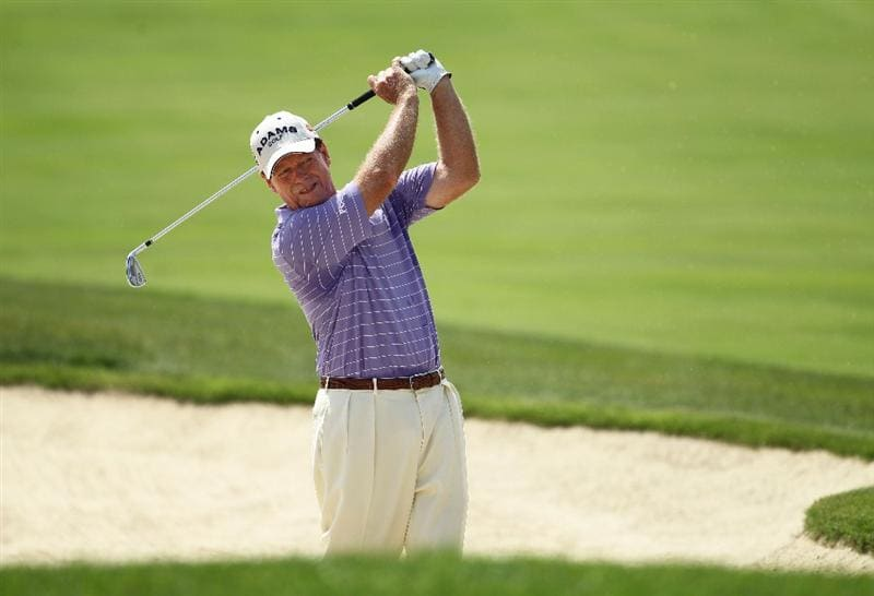 LOUISVILLE, KY - MAY 29:  Tom Watson hits his second shot on the par 5 10th hole during the Senior PGA Championship presented by KitchenAid at Valhalla Golf Club on May 29, 2011 in Louisville, Kentucky.  He won in a one hole playoff over David Eger .  (Photo by Andy Lyons/Getty Images)